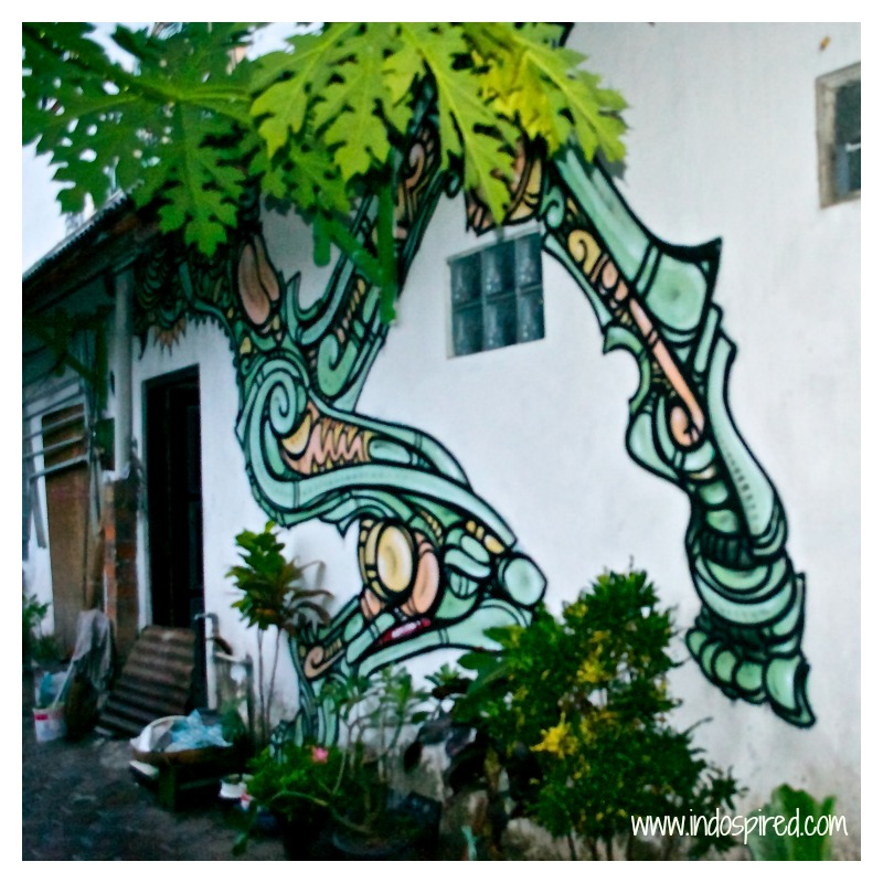 Yogya Street art PD2 legs on house