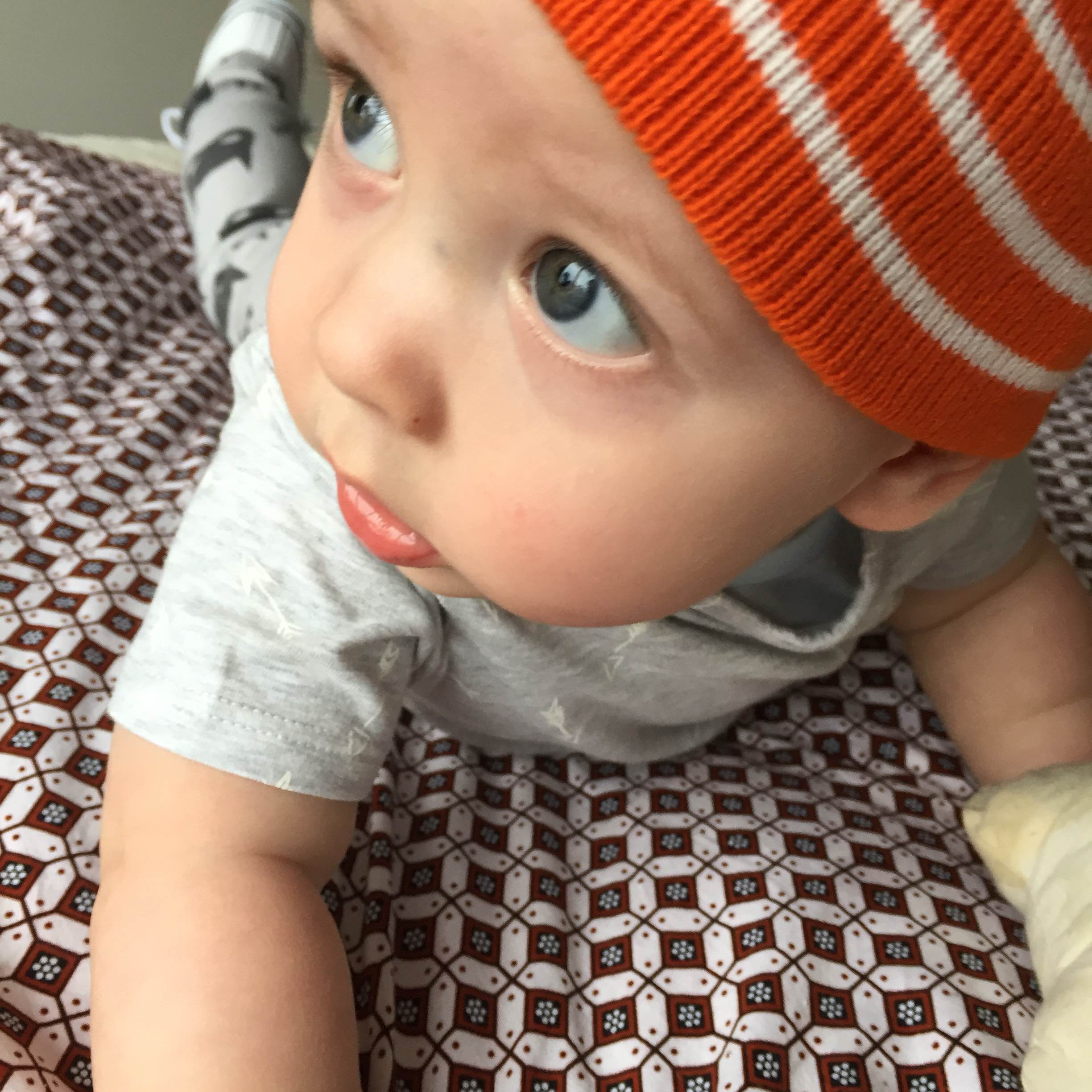 SJ 8 months old orange beanie kid